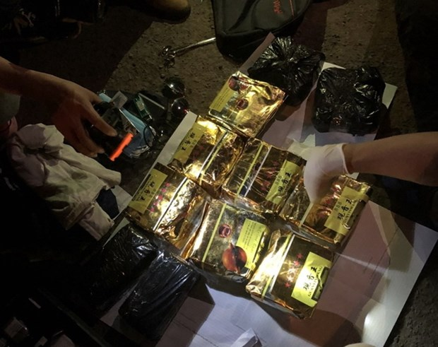 Quang Tri: Bat doi tuong van chuyen 11kg ma tuy vao phia Nam tieu thu hinh anh 1