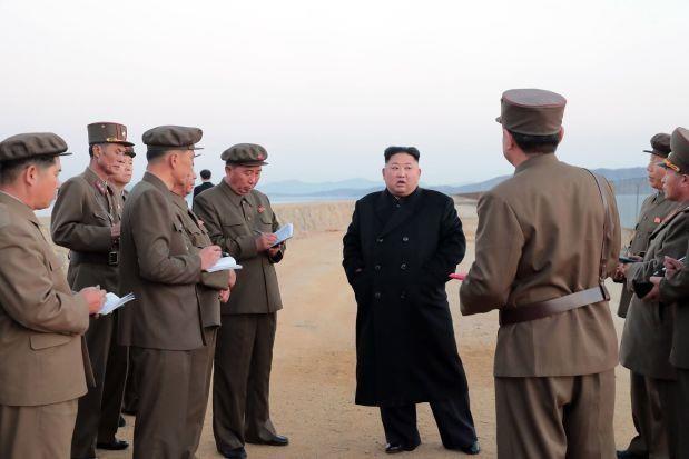 Chu tich Trieu Tien Kim Jong-un chu tri hoi nghi sy quan quan doi hinh anh 1