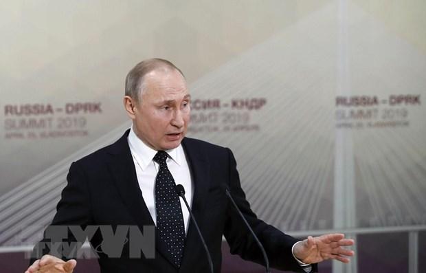 Tong thong V.Putin neu dieu kien Nga do bo lenh trung phat EU hinh anh 1