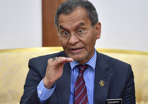 Malaysia chua nang muc canh bao voi dich benh COVID-19 hinh anh 1