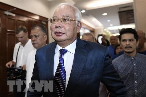 Cựu Thủ tướng Malaysia Najib Razak tới Tòa án Tối cao Kuala Lumpur. Ảnh: AFP/TTXVN