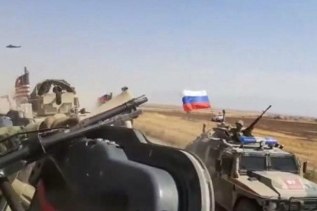 Xe quan su Nga va My va cham tai Syria, co nguoi bi thuong hinh anh 1