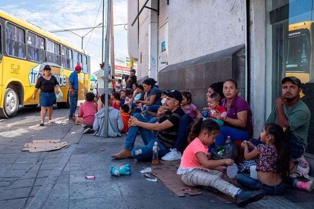 Mexico len ke hoach ho tro nguoi di cu bi ket do chinh sach cua My hinh anh 1