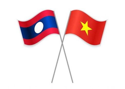 Dai su quan Lao chuc Tet Dai su quan Viet Nam tai Singapore hinh anh 1