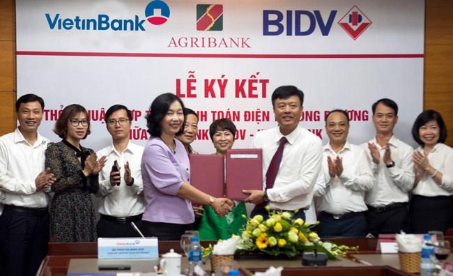 Ba ngân hàng bắt tay đồng triển khai dịch vụ thanh toán điện tử - ảnh 1