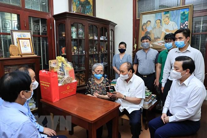 Chủ tịch nước thăm một số nhà báo, gia đình nhà báo lão thành ảnh 5