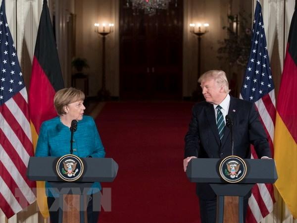Su kien quoc te 13-19/3: Co gi trong cuoc gap giua Trump-Merkel hinh anh 1