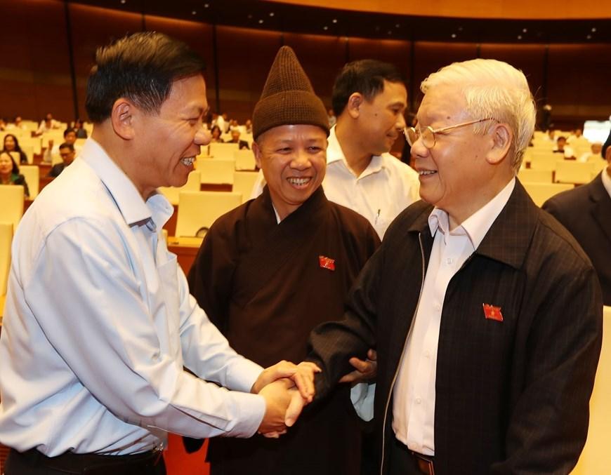 Tổng Bí thư, Chủ tịch nước Nguyễn Phú Trọng với đại biểu Quốc hội tại Phiên chất vấn chiều 8/11. (Ảnh: Trí Dũng/TTXVN)