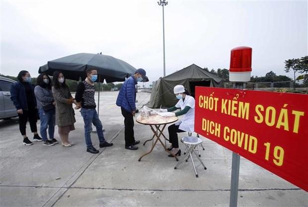 Lập chốt kiểm soát phòng, chống dịch COVID-19 trên Quốc lộ 12C   Xã hội    Vietnam+ (VietnamPlus)